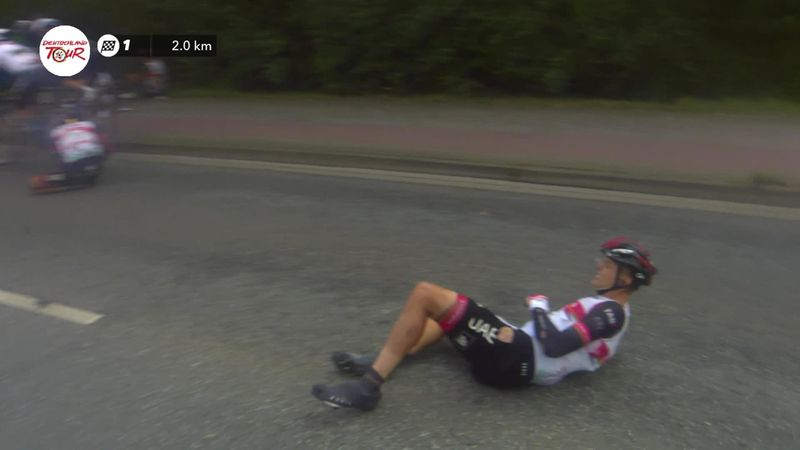Number of riders caught up in crash just over 2km from the finish line