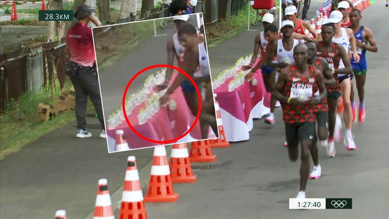 'Off the table!' - Shocking moment marathon runner knocks drinks off table, takes one