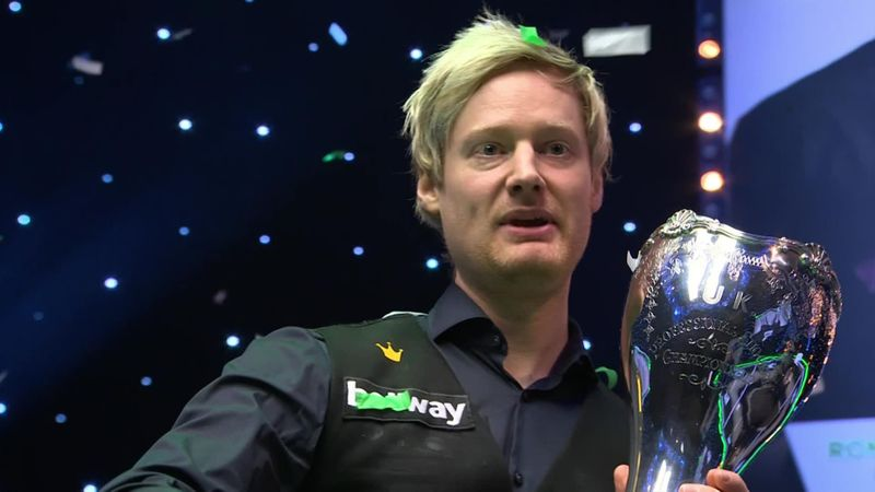 Exhausted Robertson lifts trophy and picks up £200,000 prize