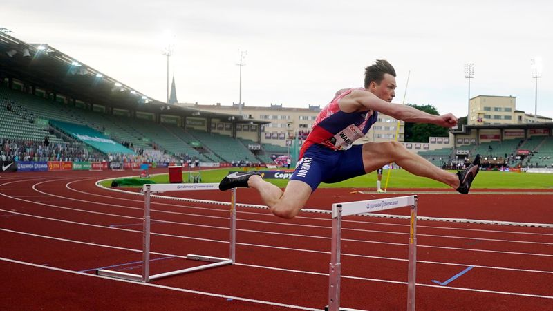 Warholm sets 300m hurdles world record in front of cardboard fans